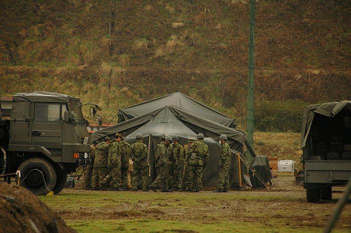 Japanese self defense force gathered at tsunami evacuation center