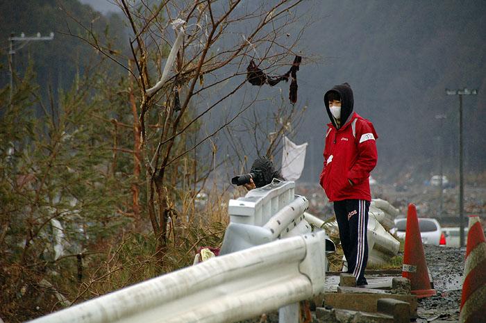 two volunteers surveying the tsunami destruction of downtown Minami Sanrikucho