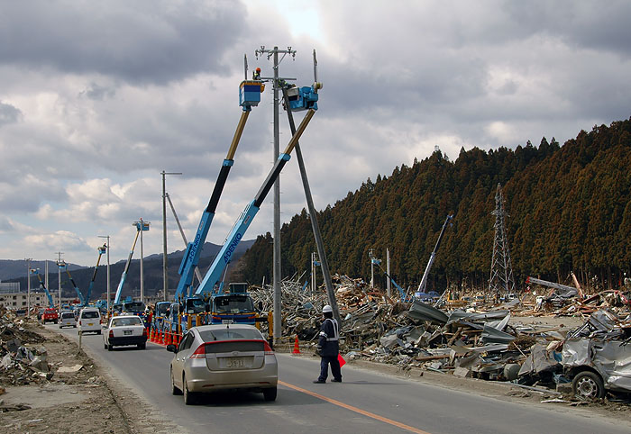 new telephone poles being put in only a few days after the tsunami