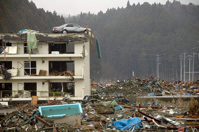 car lifted to apartment building roof by tsunami