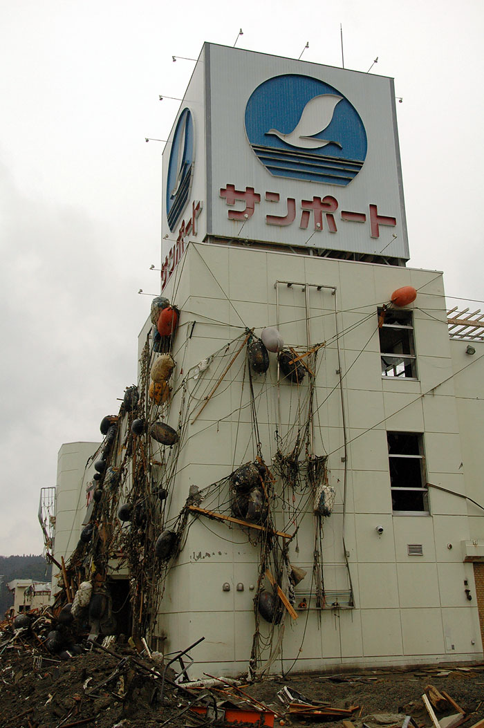Minami Sanriku building wrapped in trawling nets by tsunami